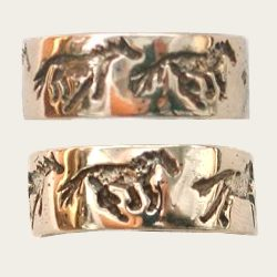 Carved galloping horse ring